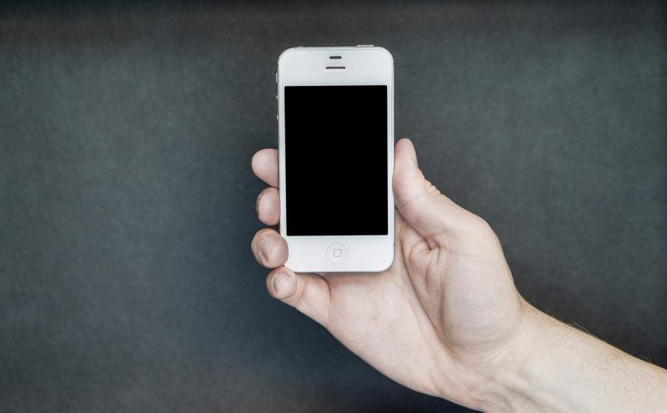 Download Free Stock HD Photo of A hand posing with a smartphone Online