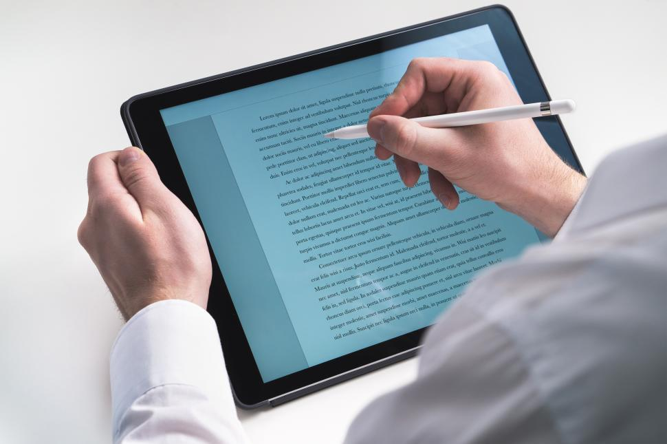 Download Free Stock HD Photo of Close up of person using a stylus tip on the tablet PC screen Online