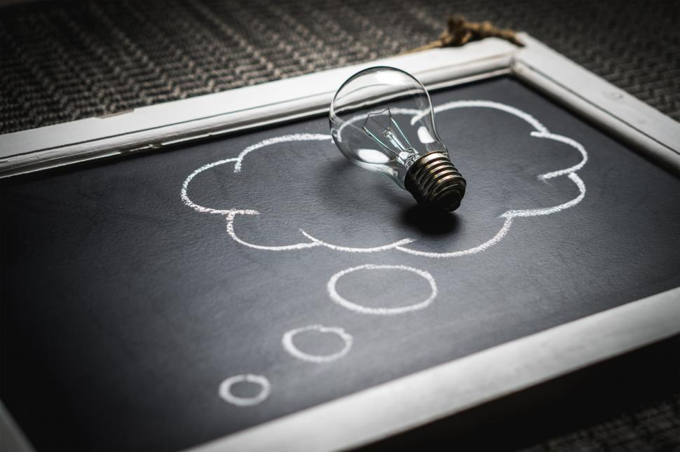 Download Free Stock Photo of A thought bubble created with chalk and light bulb
