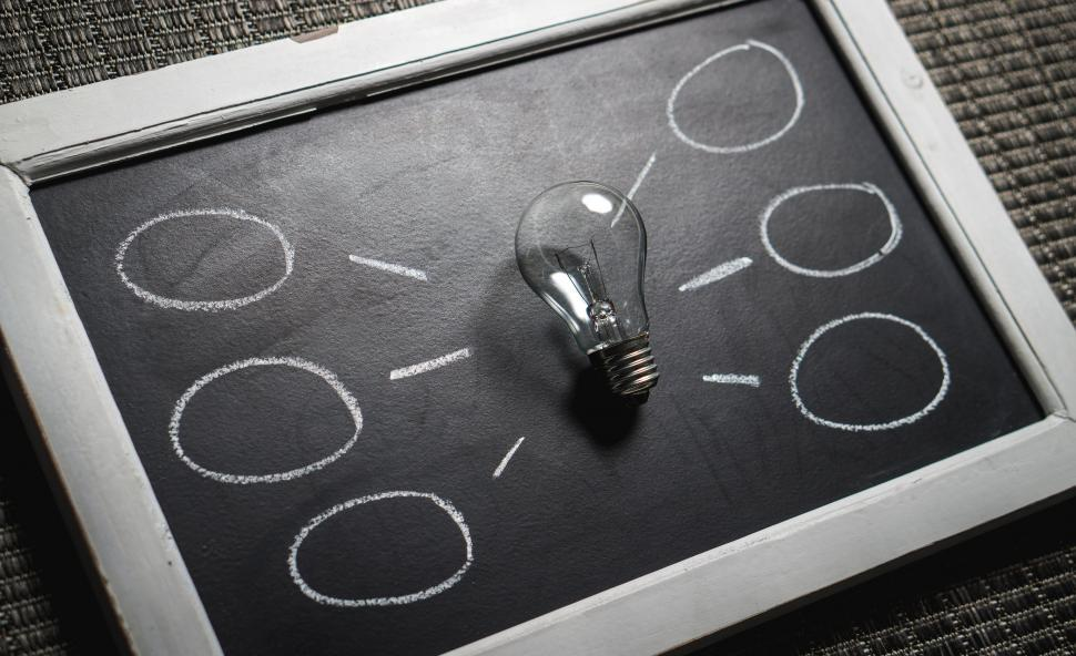 Download Free Stock Photo of A mind map created with chalk and light bulb
