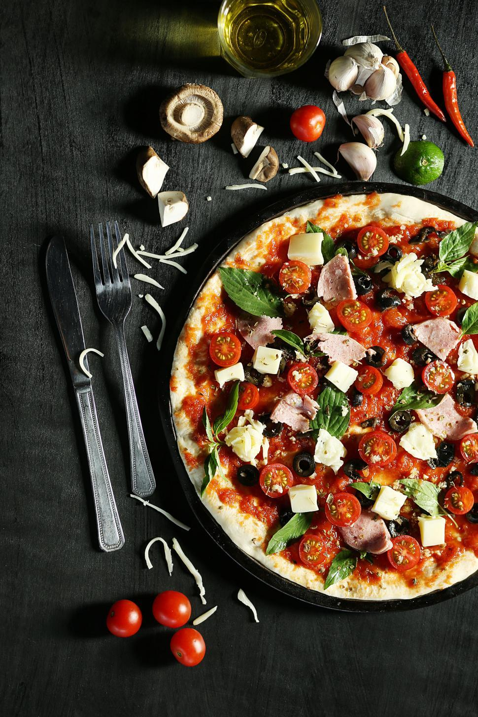 Download Free Stock Photo of Freshly baked pizza with melted cheese mushrooms and basil