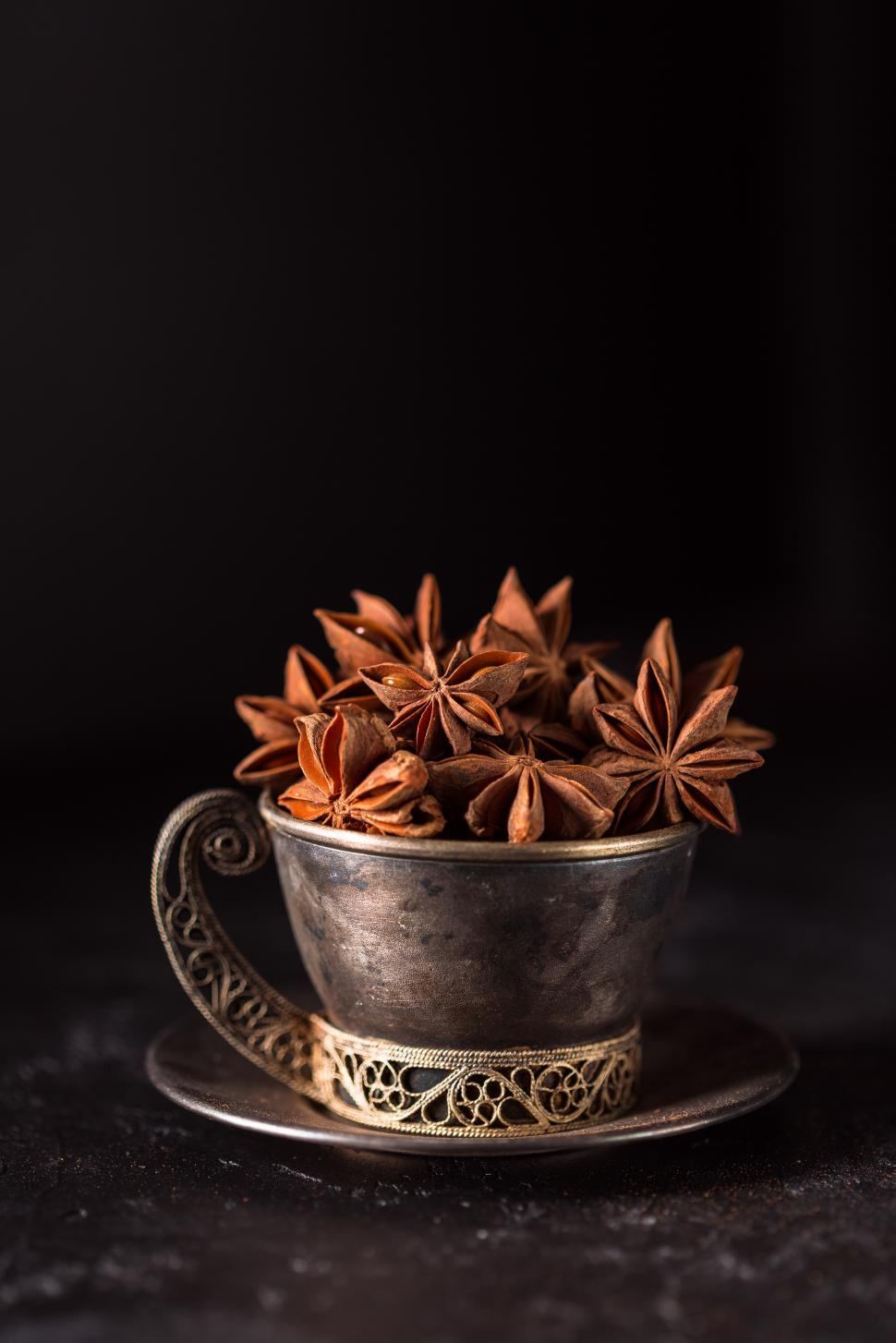 Download Free Stock HD Photo of Metal cup full of Star Anise Online