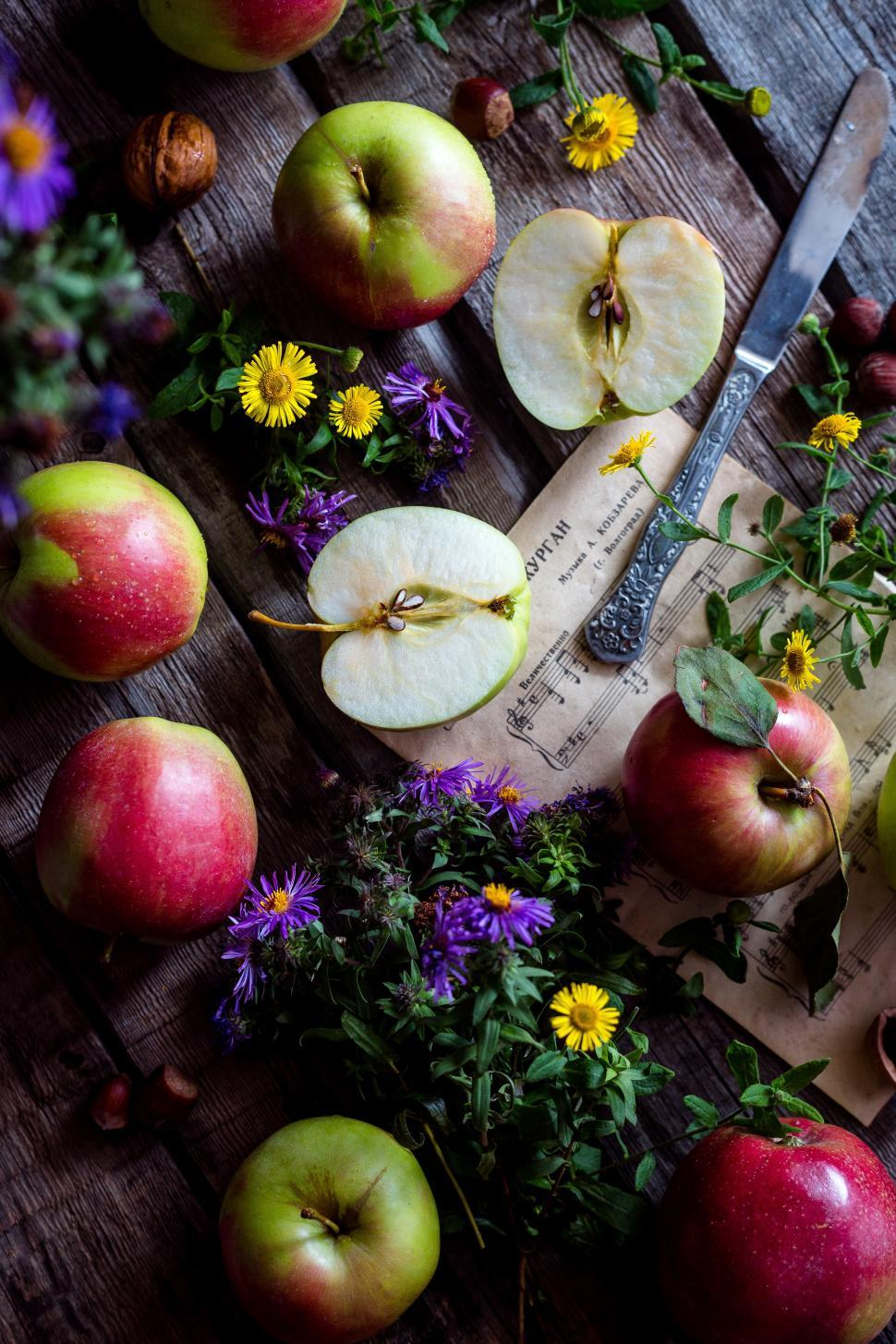Download Free Stock HD Photo of Apples and flowers on desk Online