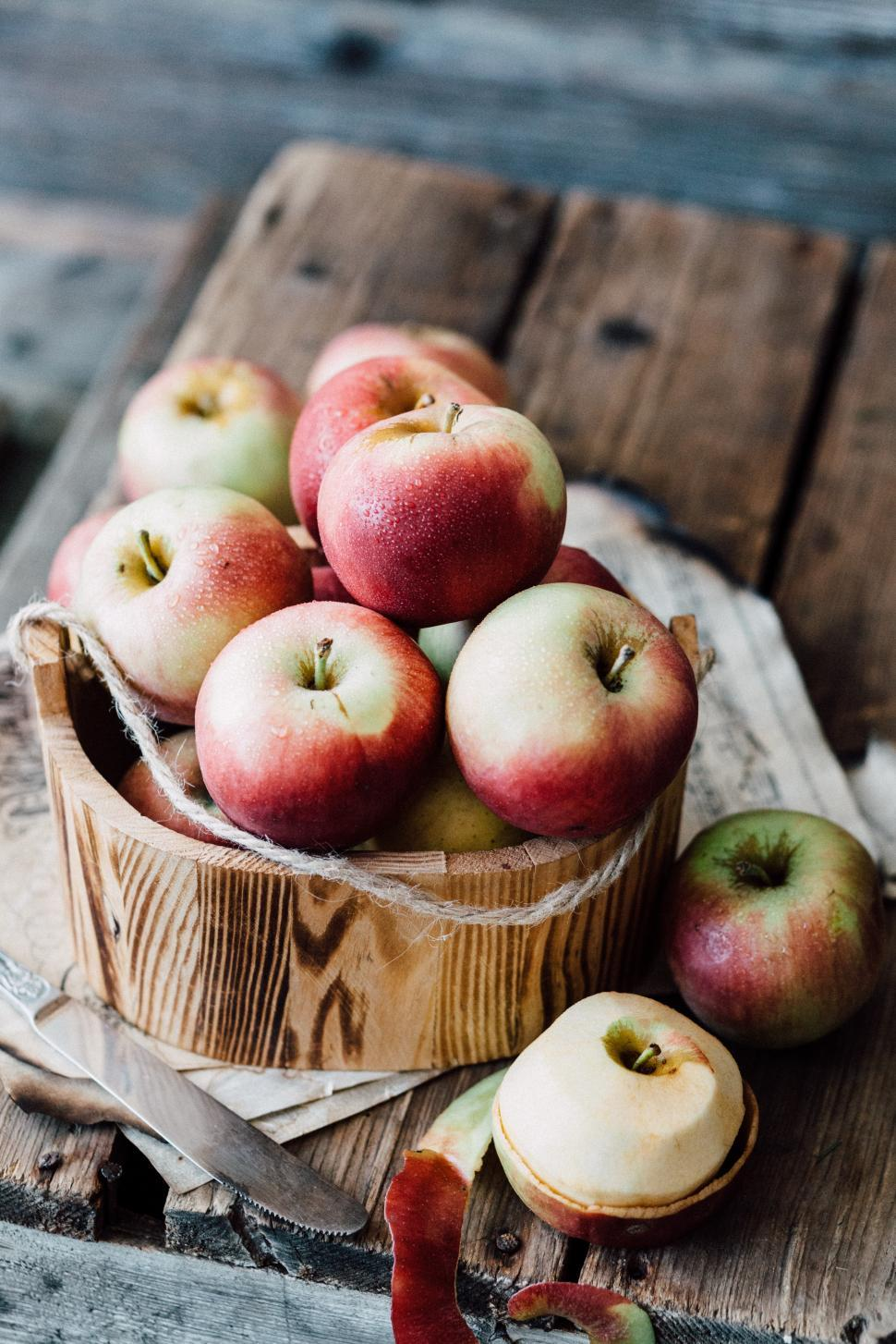 Download Free Stock HD Photo of Close-up of fresh red apples on wooden desk Online