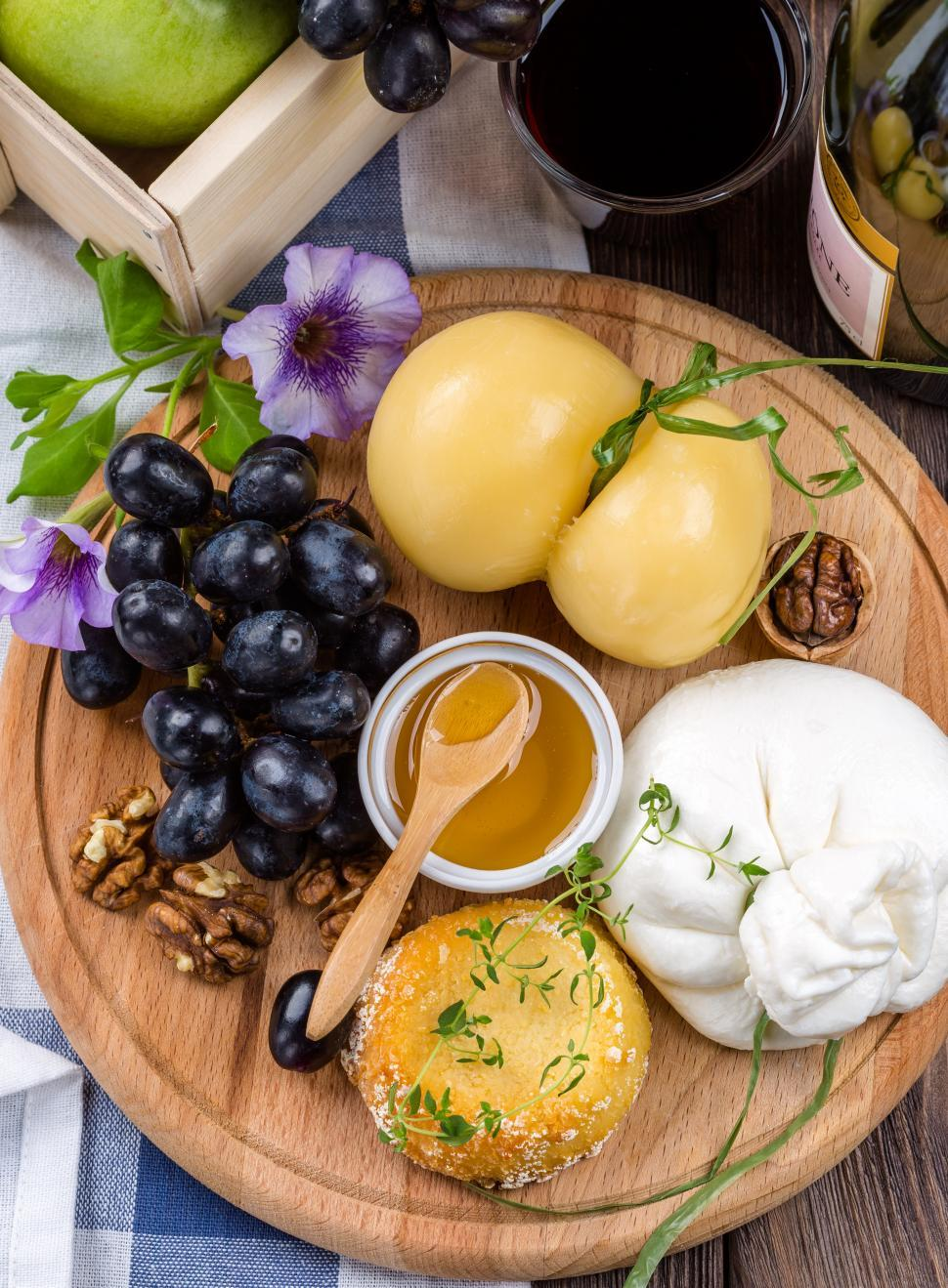 Download Free Stock HD Photo of Cheese and fruits on wooden board Online