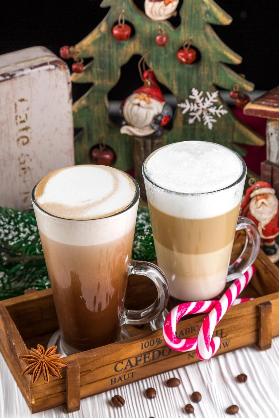 Download Free Stock HD Photo of Close up of frothy, layered cappuccino in a clear glass mugs Online
