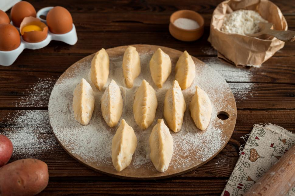 Download Free Stock HD Photo of Close up Russian pirozhki baked patties ready to be baked Online