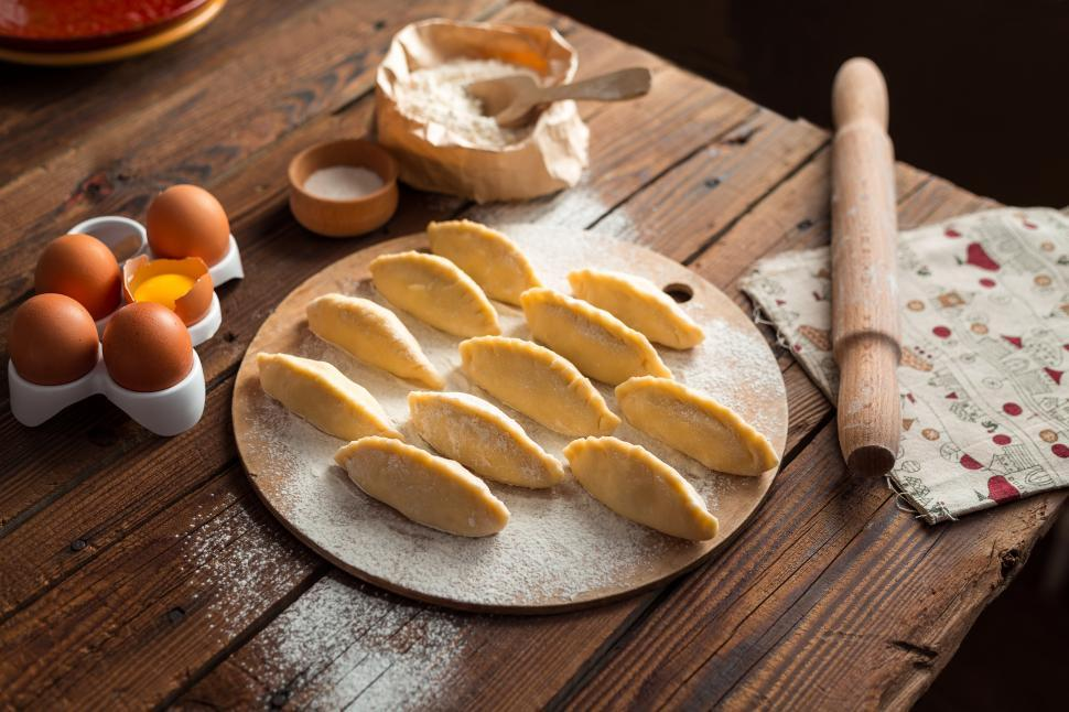 Download Free Stock HD Photo of Close up of table with Russian pirozhki baked patties ready to be baked Online