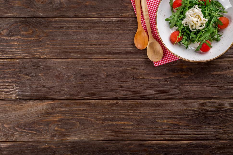Download Free Stock HD Photo of Overhead view of vegetable salad in a white ceramic plate Online