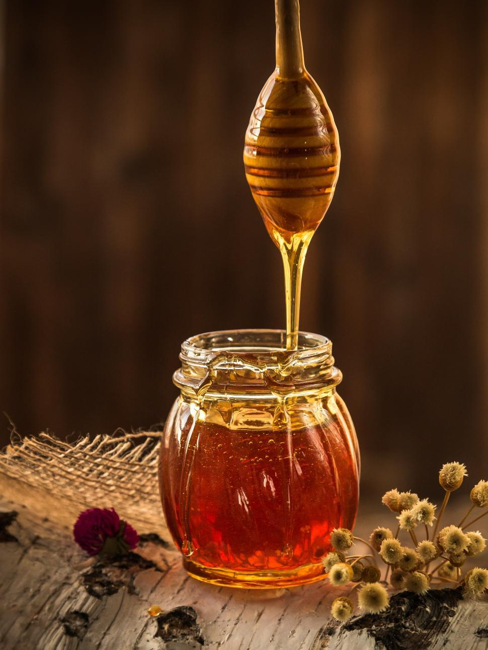 Download Free Stock Photo of Honey dripping from dripper into the glass jar