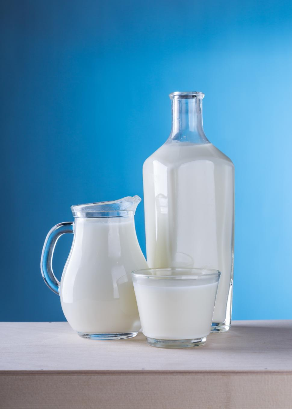 Download Free Stock HD Photo of Close up of a glass, a pitcher and a bottle Online