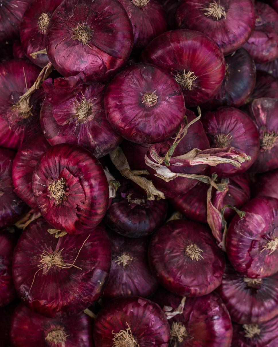 Download Free Stock HD Photo of Close up of a pile of red onions Online
