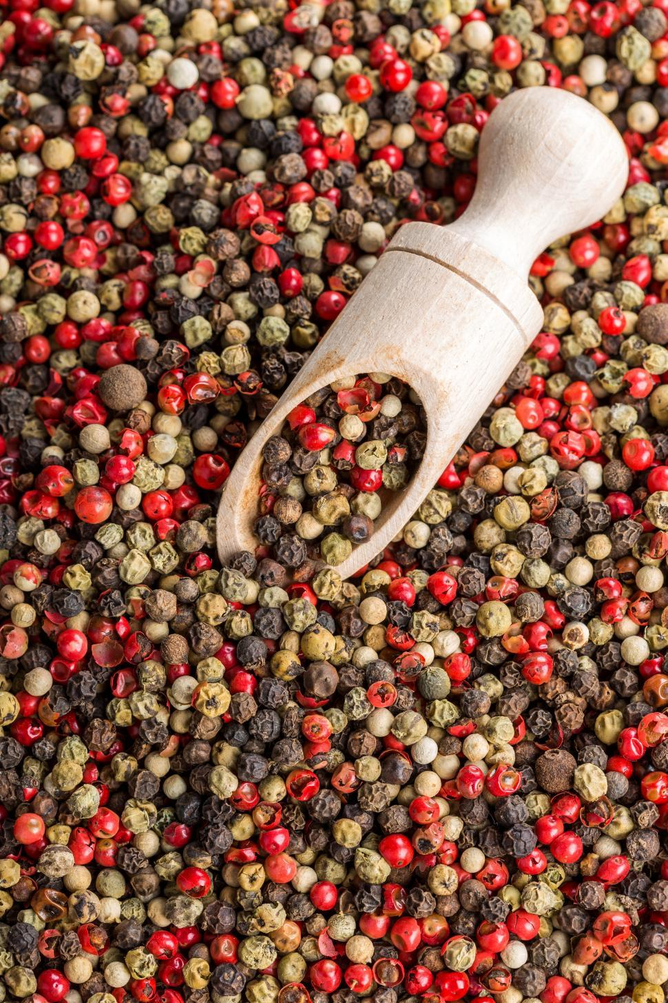 Download Free Stock HD Photo of Overhead view of dried pink peppercorn and black pepper Online