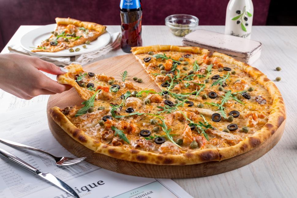 Download Free Stock Photo of Pizza and hand close up