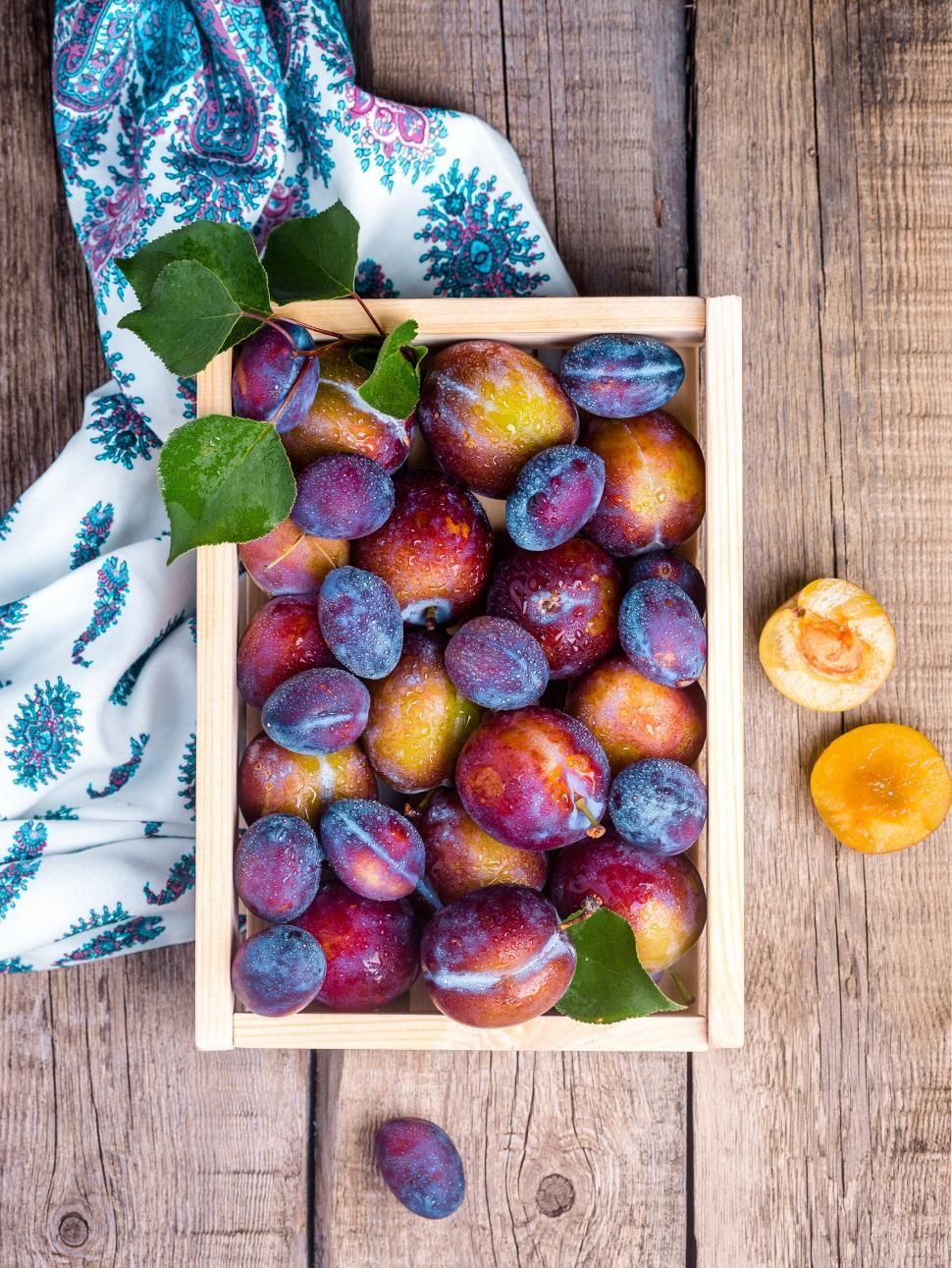Download Free Stock HD Photo of Overhead view of a crate full of ripe plums Online