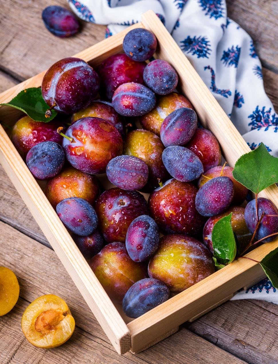 Download Free Stock HD Photo of Overhead view of a crate of plums Online