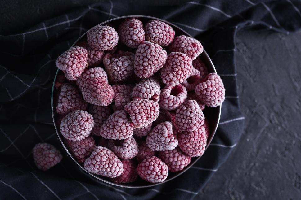Download Free Stock HD Photo of Overhead view of frozen raspberries Online