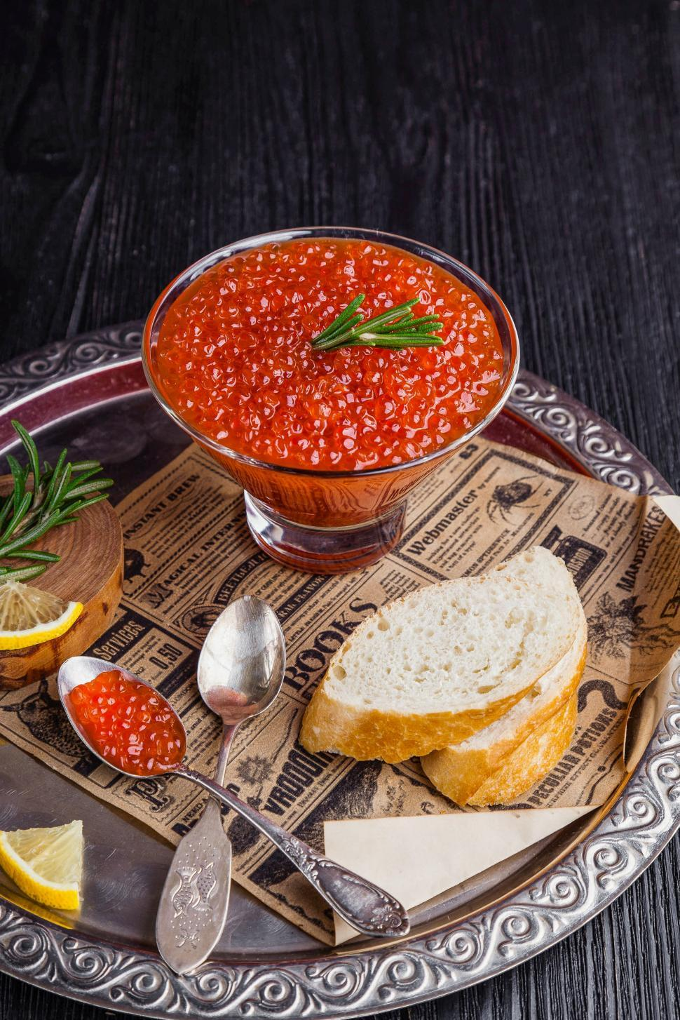 Download Free Stock Photo of Close up of a bowl of red caviar garnished with rosemary leaves