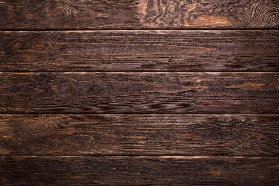 Download Free Stock HD Photo of Close up of horizontal rough dark wood board texture Online