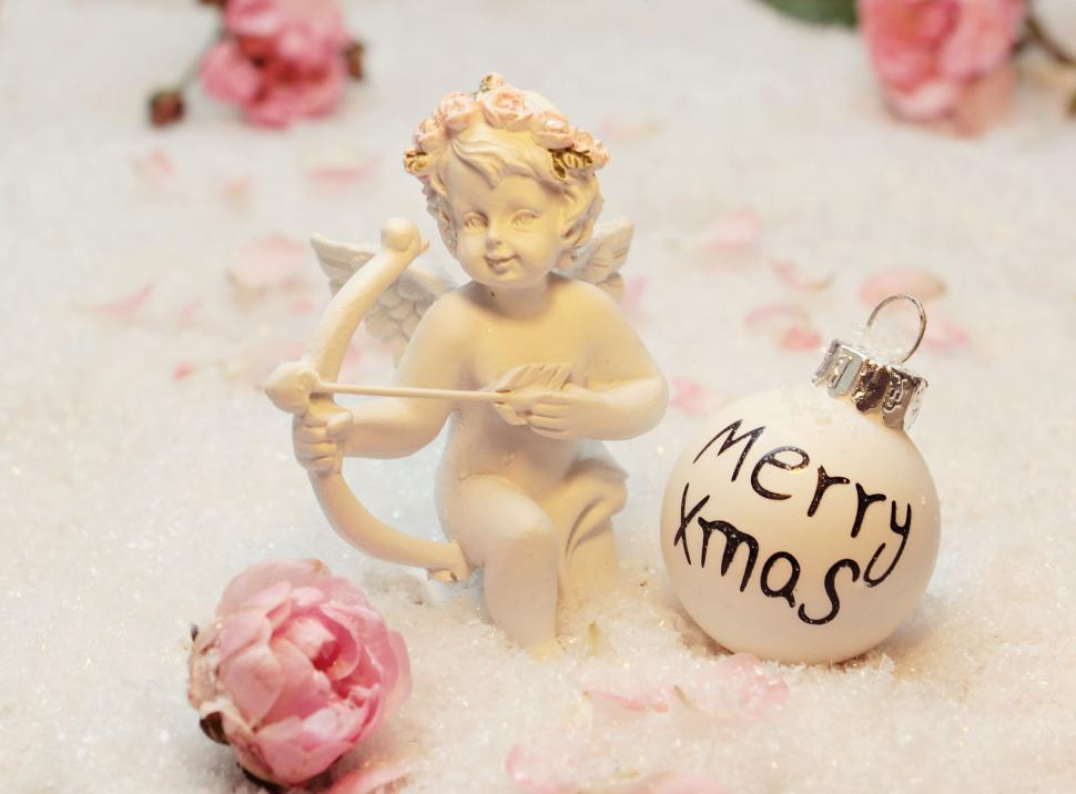 Download Free Stock HD Photo of Angel figurine with Christmas Ornament Online