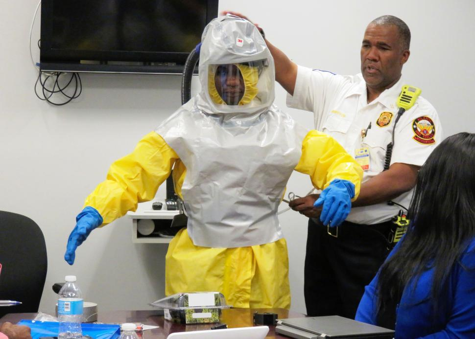 Download Free Stock HD Photo of Police and Person in Contamination Suit Online