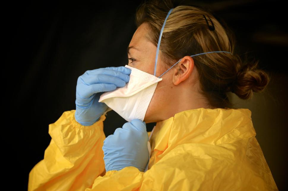 Download Free Stock Photo of Woman in Mask, Gloves, and Gown - PPE