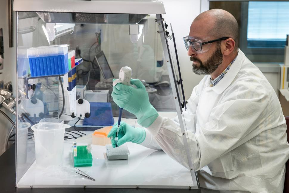 Download Free Stock Photo of CDC Scientist in Lab Environment