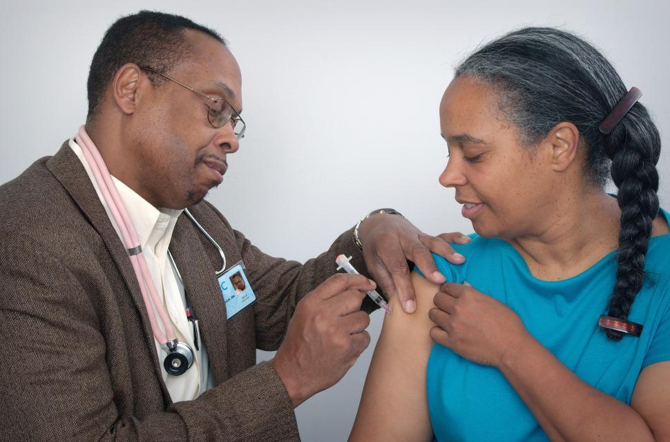 Download Free Stock HD Photo of Woman Receiving Immunization Online