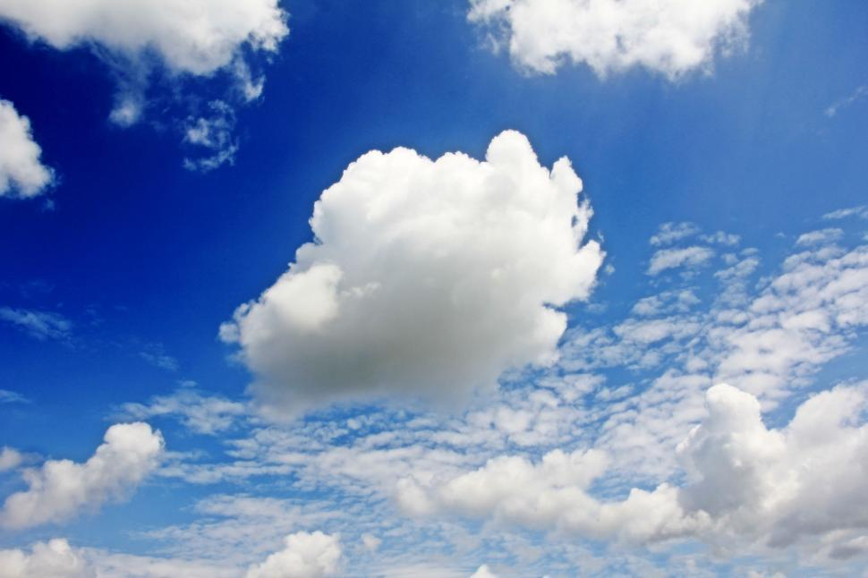 Download Free Stock Photo of Fluffy cloud in mostly blue sky