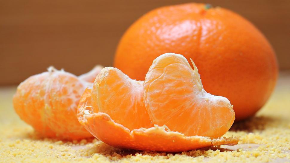 Download Free Stock Photo of Tangerine Segments and Peel