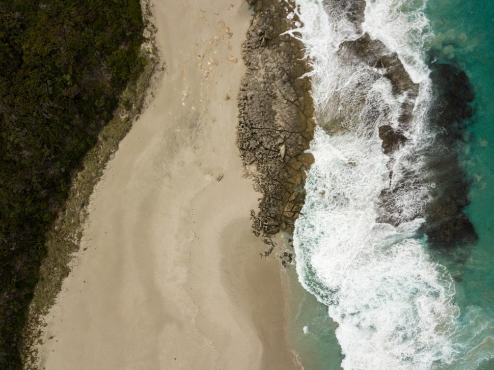 Download Free Stock HD Photo of Aerial view of ocean waves and empty beach.  Online