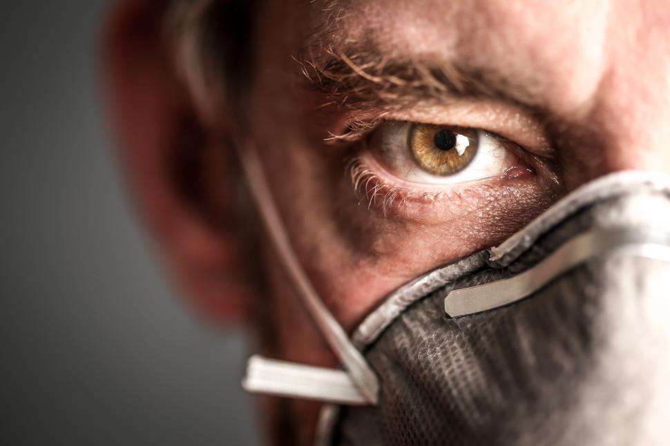 Download Free Stock Photo of Close up of man wearing Respirator Mask