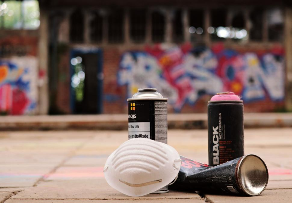 Download Free Stock Photo of Spray cans with respirator mask