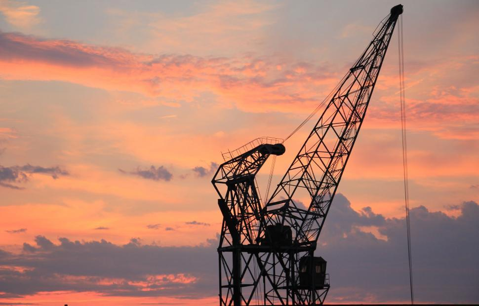 Download Free Stock HD Photo of Harbor Crane Against Sunset Sky Online