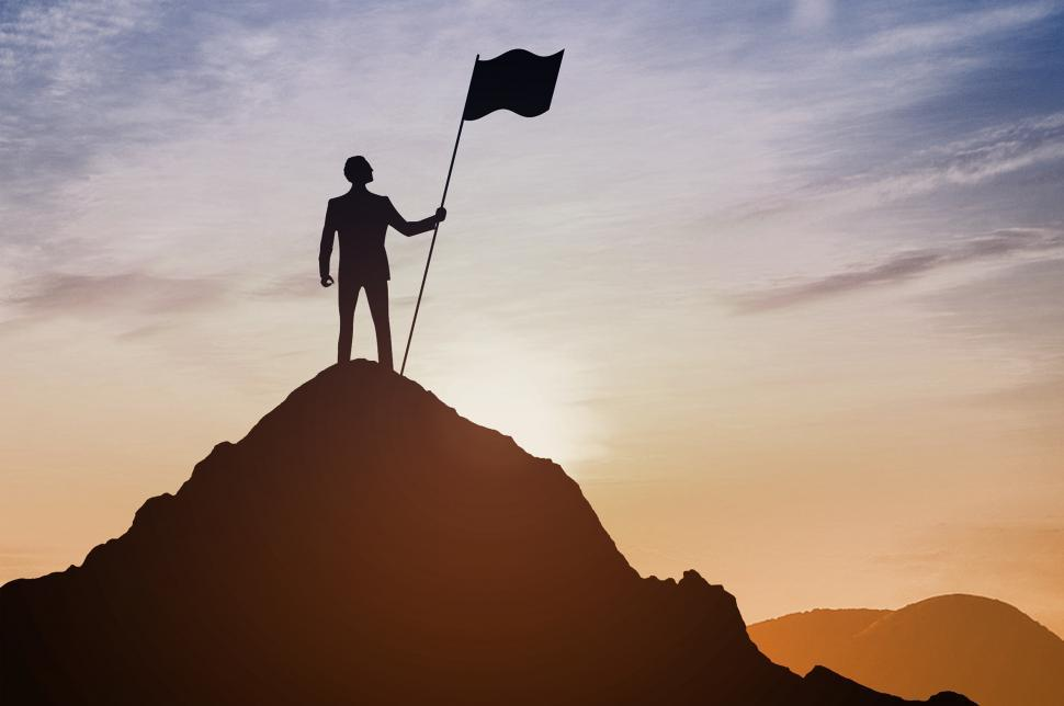 Download Free Stock Photo of Man with Flag on Top of Mountain - Close Up