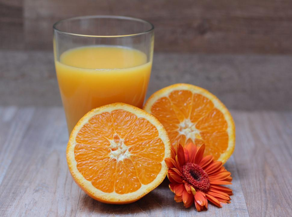 Download Free Stock Photo of Fresh orange juice with oranges