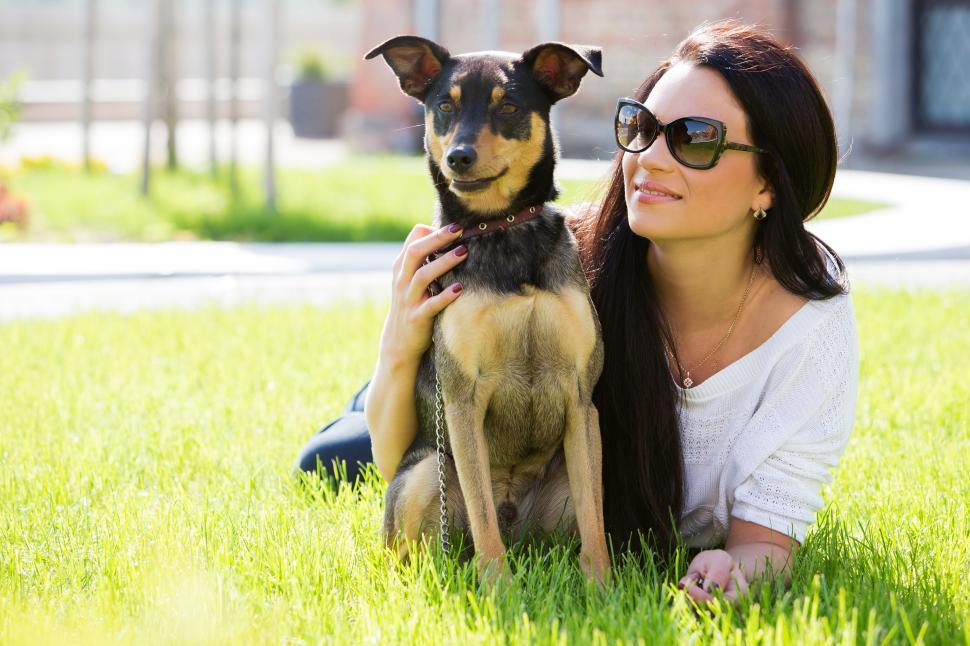 Download Free Stock Photo of Beautiful woman with dog in park