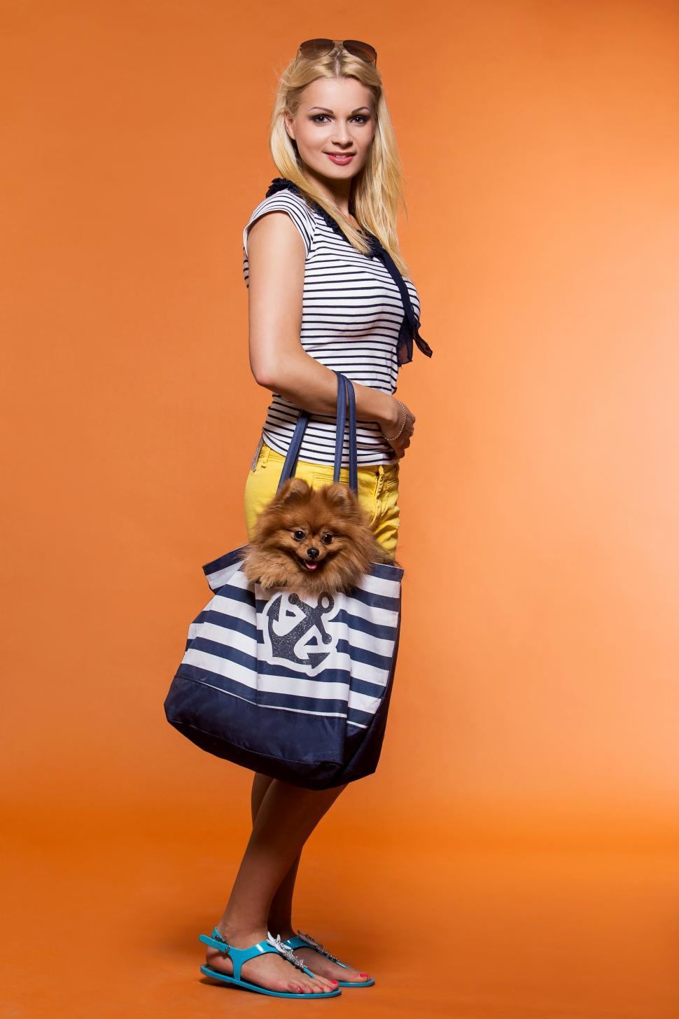 Download Free Stock HD Photo of Summer. Beautiful blonde standing with dog in large bag Online