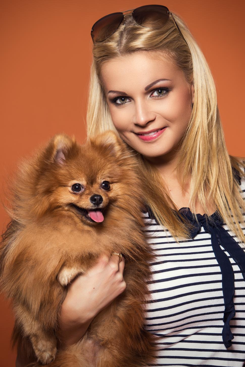 Download Free Stock HD Photo of Summer. Beautiful blonde with dog looking at camera Online
