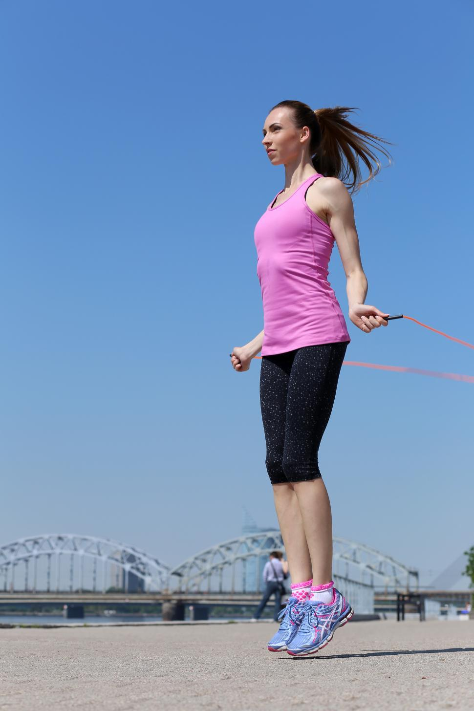 Download Free Stock Photo of Sport. Attractive girl with skipping rope