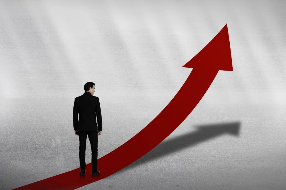 Download Free Stock HD Photo of Personal Growth Concept - Businessman on Red Upward Arrow Online