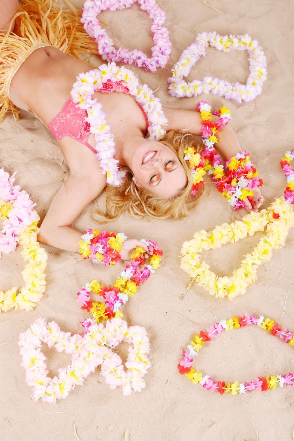 Download Free Stock HD Photo of Beautiful woman relaxing hawaii style with Lei Online