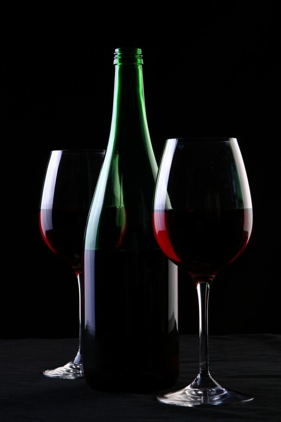 Download Free Stock Photo of a two glasses of red wine on black