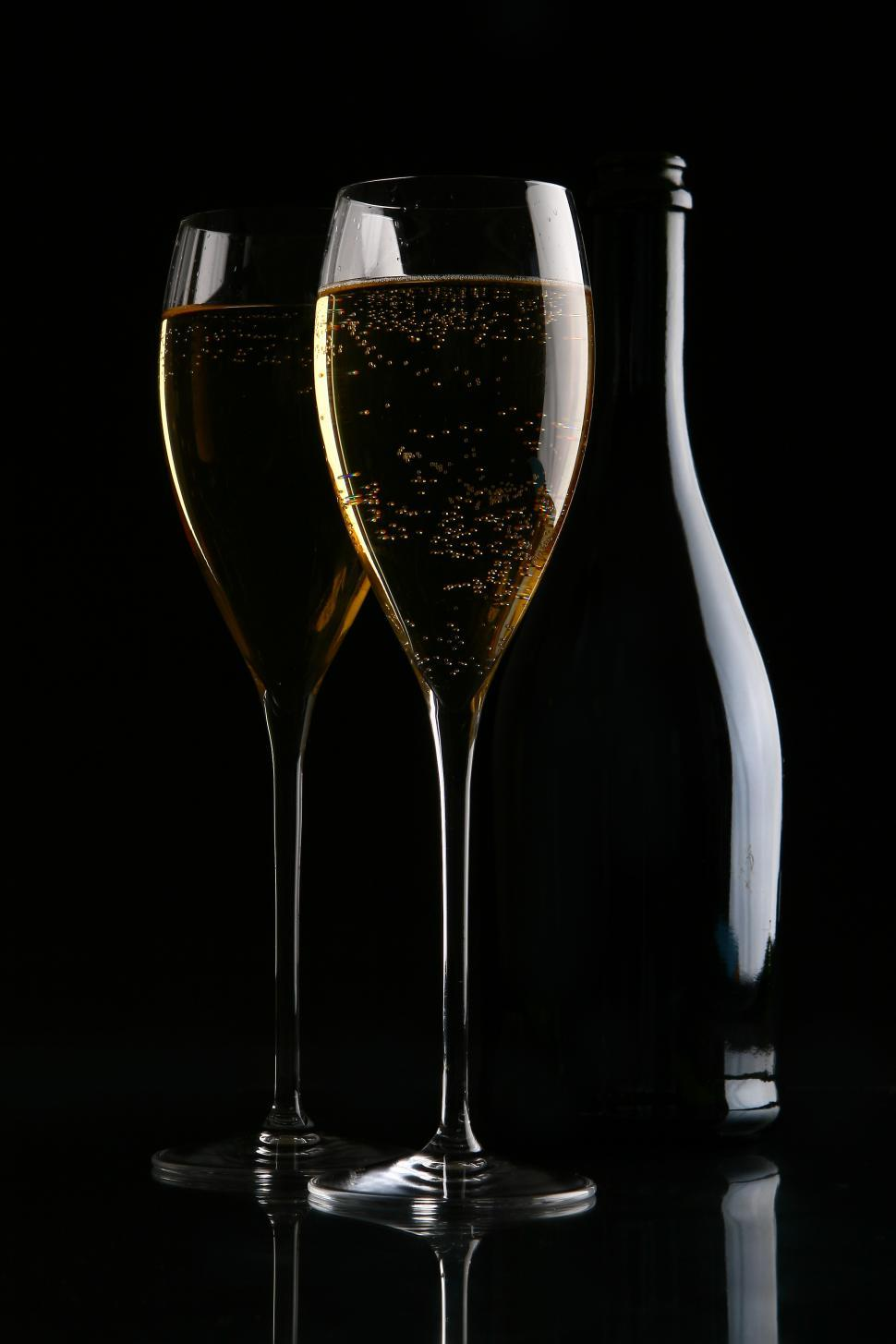 Download Free Stock HD Photo of Two elegant glasses with gold champagne Online