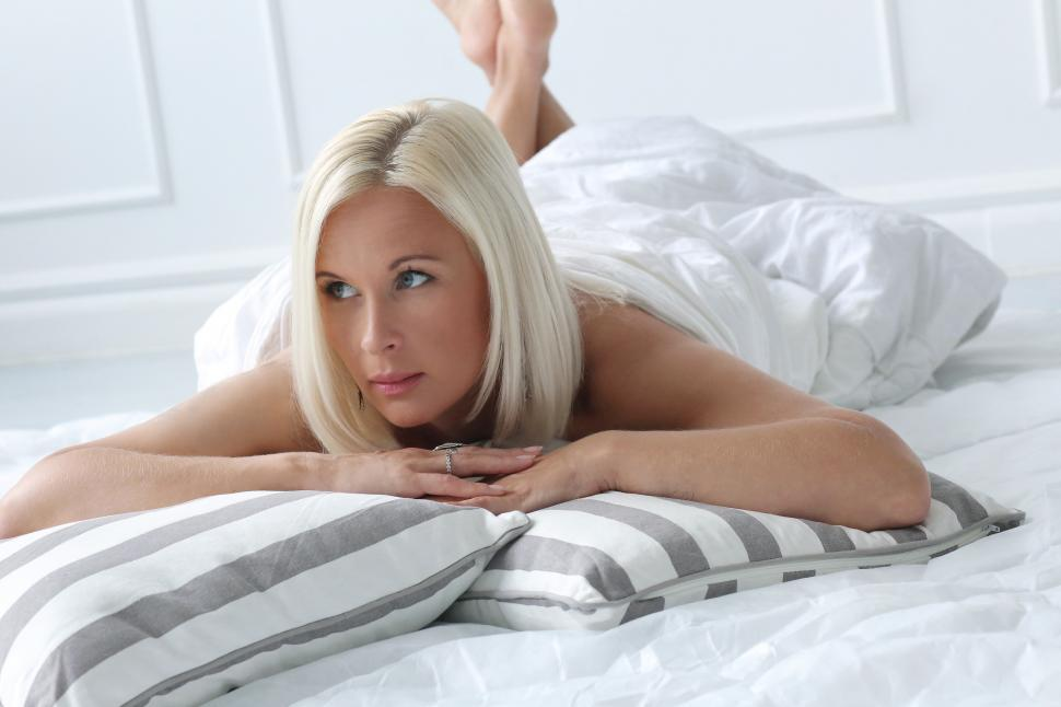 Download Free Stock Photo of Cute, blonde girl with blue eyes laying down
