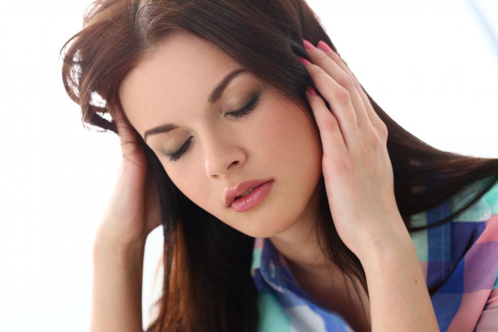 Download Free Stock Photo of Beautiful girl has headache