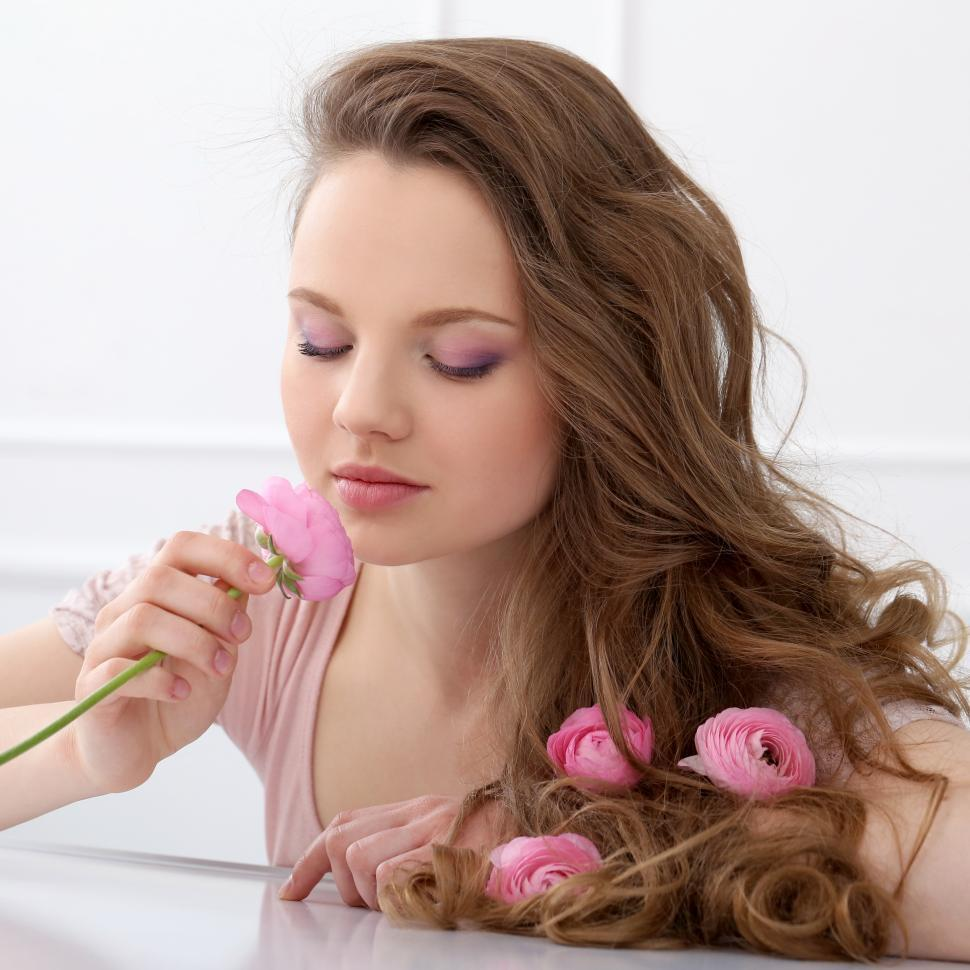 Download Free Stock Photo of Beautiful girl with long hair smelling flower