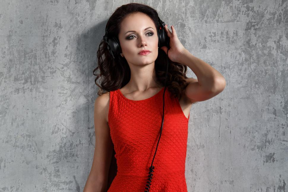 Download Free Stock HD Photo of Dj, music. Woman in red with headphones Online