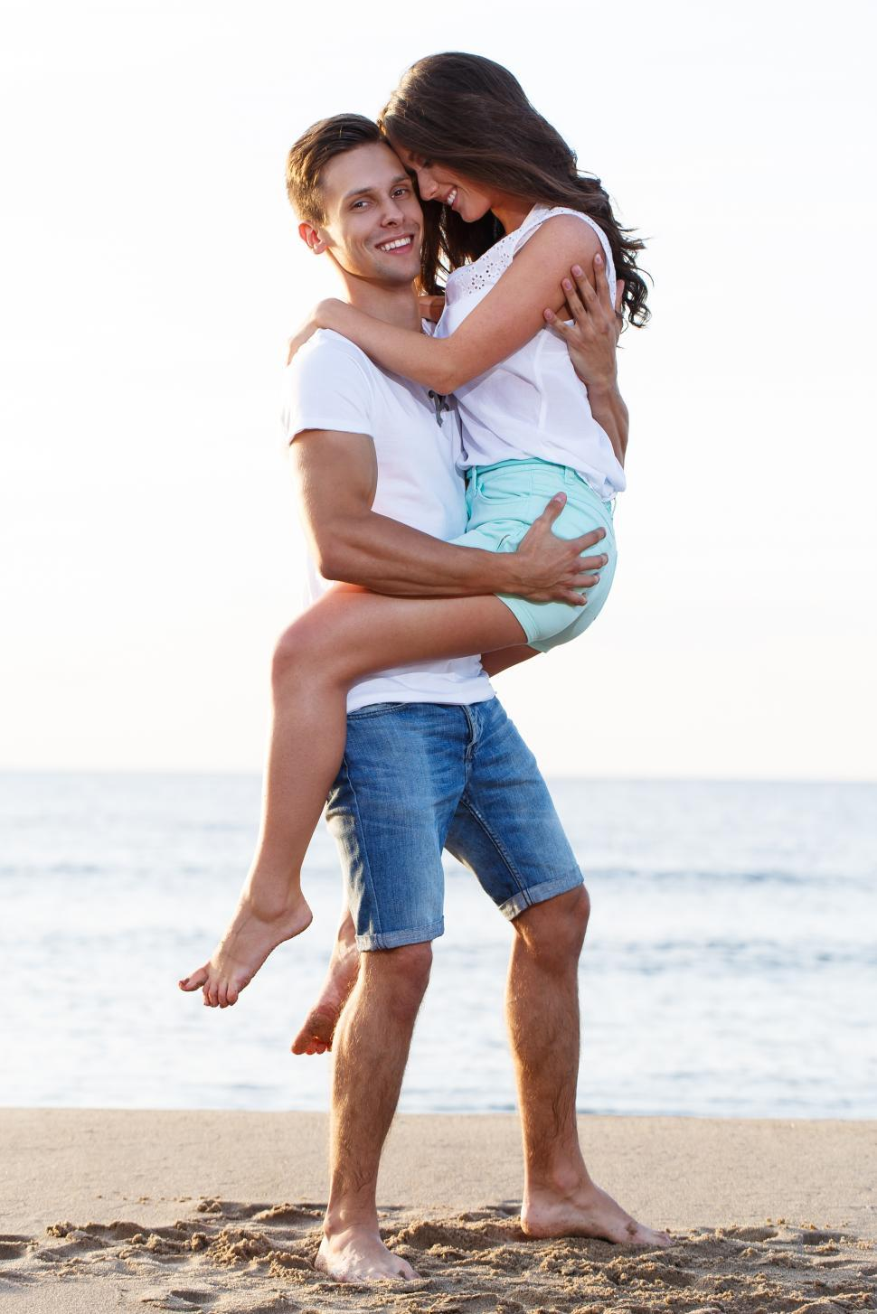 Download Free Stock HD Photo of Beautiful couple on the beach Online