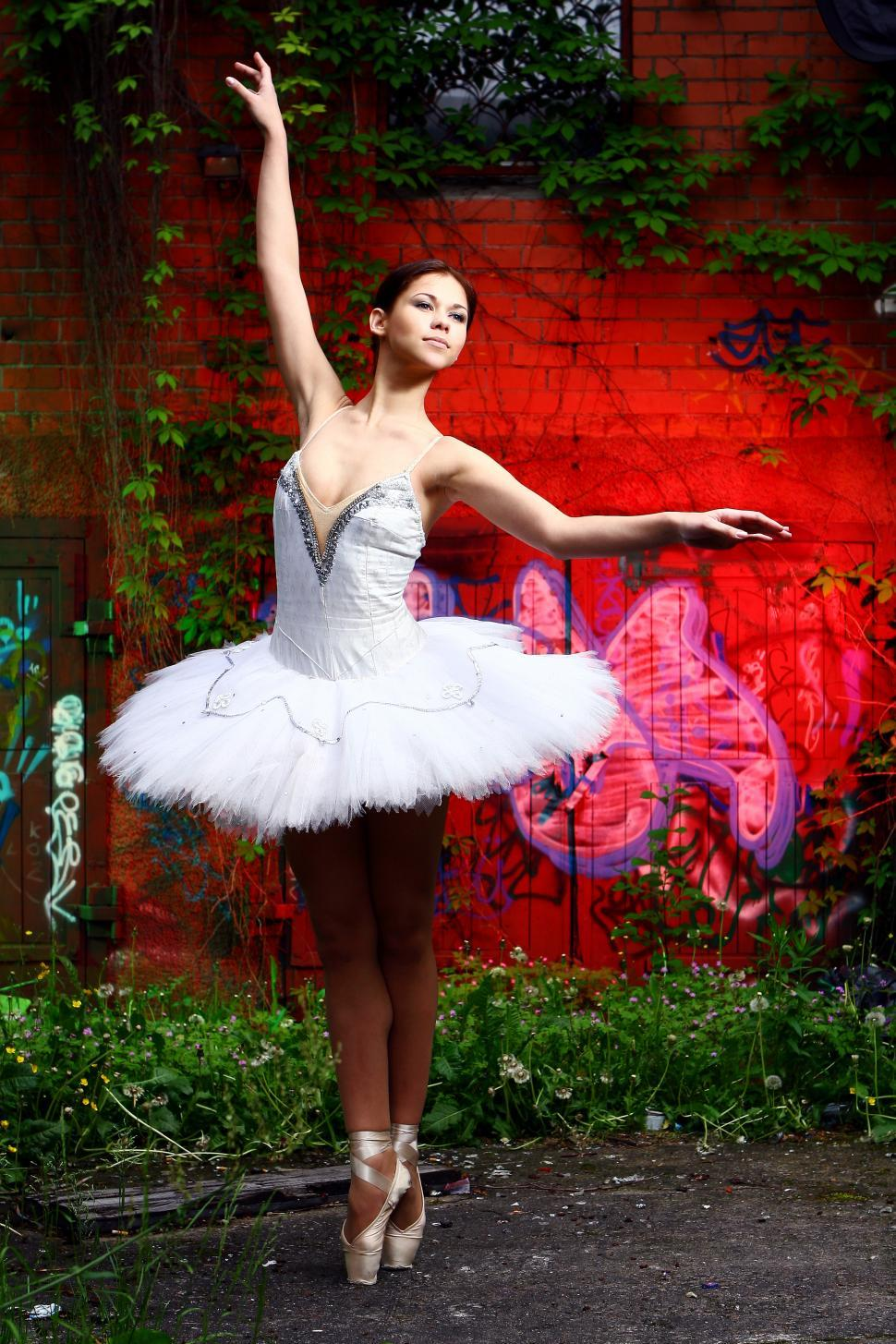 Download Free Stock Photo of beautiful ballerina dancing ballet on colorful background